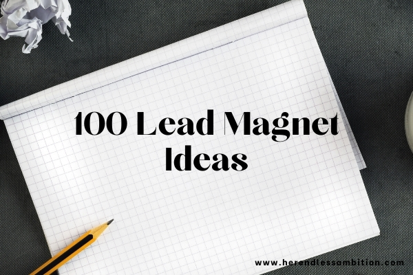 100 Lead Magnet Ideas text overlay on image of graph paper with pen